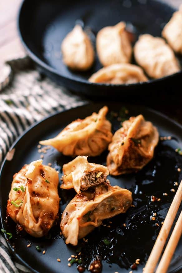 Fried Pork dumplings with a delicious pork filling with ginger, soy sauce rice vinegar, scallions and cabbage and from scratch dough.