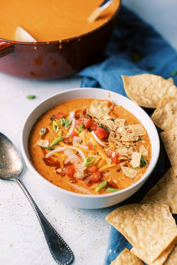 Chicken Enchilada Soup is cheesy, hearty and quite addicting. You can add rotisserie chicken in at the end to make this a quick weekend soup!