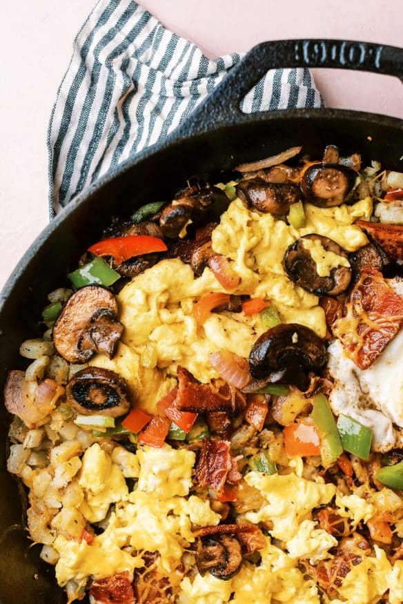 Country Style Breakfast Skillet, with over easy, scrambled and plant based egg, along with different meats and veggies for Mom, Dad and the kids!
