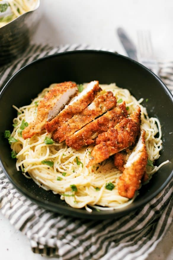 Cacio e pepe with pecorino Romano cheese topped with Italian seasoning breaded chicken cutlets - Italian comfort food at its best!